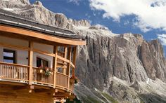 Detail of wood balconies of the Chalet Gerard with Dolomites on the background