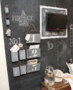 putting the color-coordinated containers right on the chalkboarded wall.