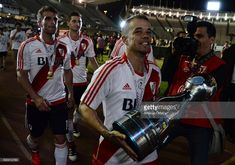Andres D´alessandro of River Plate holds the trophy after a final match between River Plate and Rosario Central as part of Copa Argentina 2016 at Mario Alberto Kempes Stadium on December 15, 2016 in Cordoba, Argentina.