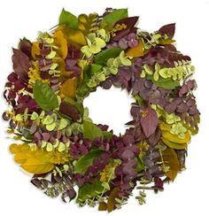 """Sunny Season Wreath 24"""" This beautiful fan style wreath has a blend of all natural dried salal amber, basil, kiwi, plum, plum eucalyptus, yellow sesame, and chartreuse eucalyptus. It also is designed, grown and assembled in the United States. While our natural wreaths will last for many years indoors, their life outdoors may be shortened depending upon weather conditions."""