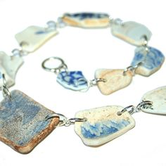 Willow sea pottery necklace.  15 pieces of sea pottery make up this willow plate inspired necklace, all made with recycled shards of pottery picked up from the lovely beaches of Cornwall.