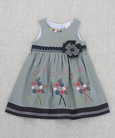 Colorful flowers and polka dots add a pop of playfulness to this twirl-worthy cotton dress.