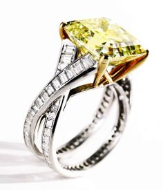 Fancy Vivid Yellow Diamond Ring, Tiffany & Co.. The emerald-cut diamond of fancy vivid yellow color weighing 9.55 carats, baguette diamonds weighing 2.13 carats.