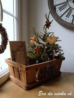 Beautiful crate filled with salt dough hearts and stars hanging on a little fir tree