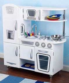 This play kitchen's detailed design and interactive features are sure to delight any small chef. The imaginary feasts from such a darling playroom addition are sure to be fantastic.Note: This item cannot be shipped to Hawaii, Puerto Rico or Alaska.Includes kitchen set, cordless phone and removable sink33'' W x 35.7'' H x 11.7'' DMedium-density fiberboardRecommended for ages 3 to 8 yearsImported