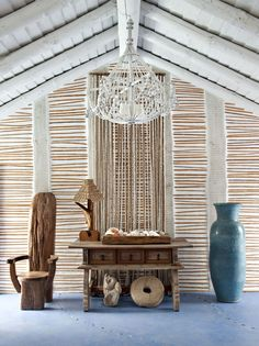 Porto Martinho - Casa do Barco - i love the wall with inserted bamboo, also love the light fixture and the general feel. Love Vera Iachia
