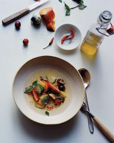 Tomato and Mango Salad with Chiles and Tomato Essence - This colorful mix is dressed with tomato water, which is made by draining pureed tomatoes for a day. It may look pale, but its flavor is astonishing: You'll want to spoon up every drop.