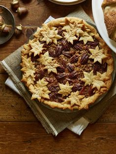 Maple Granola Pecan Pie: Dress up this year's Thanksgiving pie with some maple flavor to bring out the cinnamon and brown sugar in your filling. Find more easy homemade Thanksgiving pecan pie recipes and dessert ideas here. Köstliche Desserts, Delicious Desserts, Dessert Recipes, Pecan Pies, Best Pecan Pie Recipe, Thanksgiving Desserts, Pie Recipes, Pumpkin Recipes, Holiday Recipes
