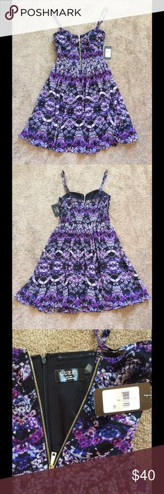 NWT Gorgeous Purple Print Guess Dress NWT Gorgeous Guess Purple Print Dress, Size 2- can fit a small 4, Has working gold tone zipper on front for deeper cleavage as desired Guess Dresses Mini