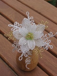 This small lily makes an exquisite bouquet. Additional flowers to enlarge the bouquet can be special ordered.