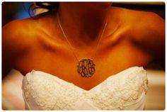 Wear a necklace with your new monogram on it during the reception to celebrate your marriage and your new last name.
