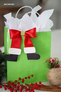 Santa Boot Bows - If you're wrapping gifts for kids this year, you must add some decorative Santa boot bows using red satin ribbon, card stock, and glue.
