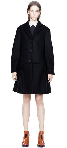 Acne Calvin Raw is a coat with a peplum hem.  Notched collar  Button and button hole allows collar to be worn up  Centre front button closures  Darts for shaping  Folded cuffs  Lined