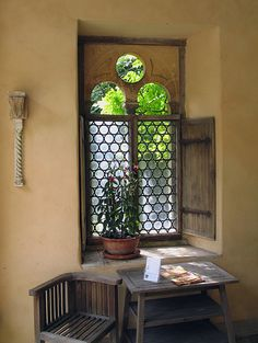 Beautiful thick walls and an ornate window creates such a chraming, inviting, and beautiful moment in a home.