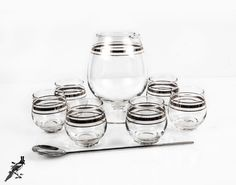 Mid Century Silver Band Martini / Cocktail Set - 6 Roly Poly Glasses with Martini Pitcher and Stirrer - So Mid Century Modern & Mad Men! by TheCordialMagpie from Etsy. Find it now at http://ift.tt/1YnW9Jg!