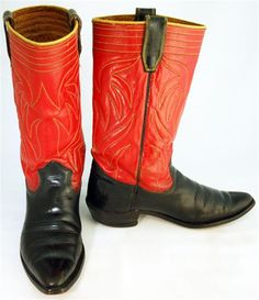 Vintage cowboy boots are mens Texas Boot Co. with fancy uppers in red with black pull straps and gold/brown double stitching, yellow piping and black vamp. $450 luckystargallery.com