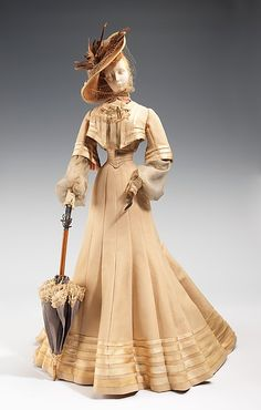 """1902 Doll"", Designer: Robert Piguet (French, born Switzerland, 1901–1953) Designer: Paulette (French) Designer: Vedrenne (French) Designer: Fernand Aubry (French) Date: 1949 Medium: metal, plaster, hair, silk, straw, cotton, feather, wood Dimensions: 31 1/2 x 14 in. (80 x 35.6 cm)"