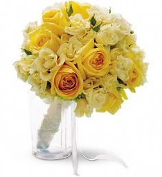 Carry a sunbeam down the aisle with this bright mix of yellow and cream roses accented with green hydrangea.