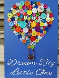 This wooden decoration, A hot air balloon made with buttons and partially string art is placed on a pink or a blue painted wooden piece (0,20x0,30m). The quote, Dream big Little One is hand painted and with swarovski rhinestones. This can be a perfect decoration for a newborn babys room. I