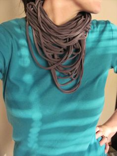"{DIY: t-shirt spaghetti scarves.}These are SO easy and look so great. Note: be SURE the tee is 100% cotton or it won't work.  Also, if you can find tees that don't have side seams, it makes much nicer ""spaghetti"" rings. Cut your strips no less that 3/4"" or they might tear open.  Mix colors! Fun project!"
