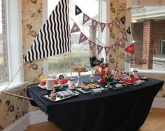 PIRATE PARTY  Very neat idea, convert the food table into a pirate ship!
