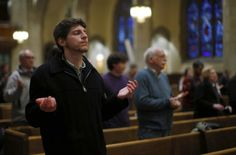 Young man prays during Mass of thanksgiving for newly elected Pope Francis at Massachusetts church  A young man prays during a Mass of thanksgiving for newly elected Pope Francis at St. Ignatius Church in Newton, Mass., March 19, the day the 76-year-old Jesuit was inaugurated as the leader of the world's 1.2 billion Catholics. (CNS photo/Brian Snyder, Reuters)