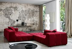 Exploring, stylish yet rustic interiors with red couch, white walls and the world map