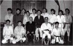 Master Toyama (Oyadomari) Kanken seated right. Master Onishi Eizo standing, black Uwagi (jacket).