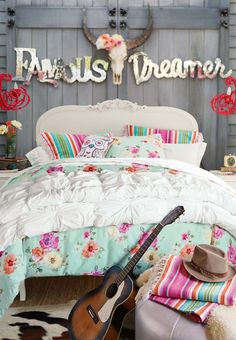 Release you inner gypsy and dream big in this country vintage bedroom.