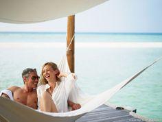 Couple enjoying their honeymoon #voyagewave #maldivesholidays -- www.voyagewave.com