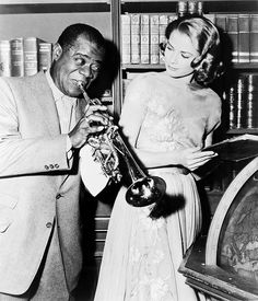 Louis Armstrong & Grace Kelly on the set of film High Society (a must-see!).