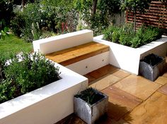 Raised Planter Beds Painted White with Contrasting Bench