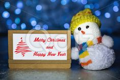 Qdiz Stock Images Christmas greeting card,  #background #blur #blurred #brown #card #celebration #Christmas #closeup #craft #decoration #doll #eve #figure #fun #funny #greeting #hat #holiday #lights #little #Merry #new #paper #scarf #small #snowman #toy #traditional #white #xmas #year #yellow