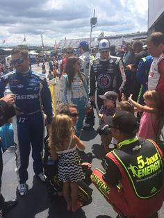 Danica Patrick talks to teammate Kevin Harvick prior to Driver Intros for the New Hampshire 301 at NHMS, 7/17/16.  Photo credit to Miss Sprint Cup via Facebook