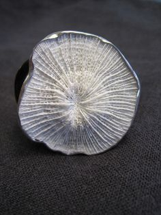 Ring | Warren and Robbin Moeller-Smith.  Sterling silver, found coral, buffalo horn