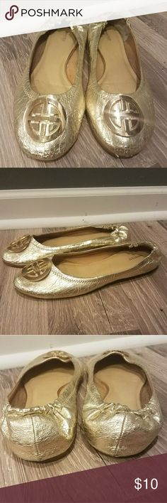 Gold flats Super cute gold flats, with a stretch heel to help keep them on. Wanted Shoes Flats & Loafers
