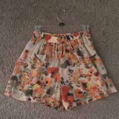 ASOS Floral Shorts ASOS Brand Zouk floral flowy shorts! Worn a small handful of times, they have a ton of life left and are perfect for spring and summer! Super stretchy at the waist and can be worn as high waisted or on hips ASOS Shorts