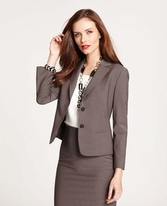 """Suit yourself: business casual or buttoned up, this indispensable jacket is a sharp suiting piece that works 9-5, 24/7. Notched lapel. 3/4 sleeves. Two-button front. Front welt pockets. Lined. 20 1/2"""" long."""