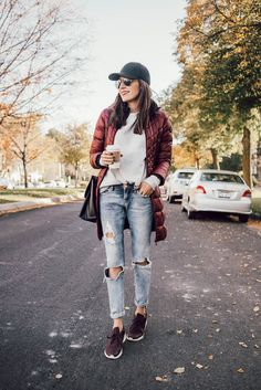 Fall Weekend Uniform: Distressed denim, nikes, sweatshirt, baseball cap, and puffy jacket