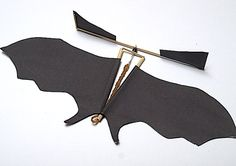 Make your own antique toy-inspired paper batcopter with this fun CRAFT tutorial!