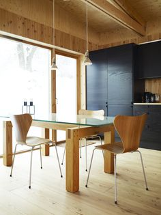 Black and blond are a natural match in Bornstein's largely wooden kitchen.  Photo by: Pia Ulin      Read more: http://www.dwell.com/slideshows/knotty-by-nature.html?slide=25=y=true##ixzz267Q0uasj