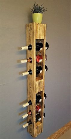 Such a wine rack can be produced from a pallet and some excess plywood. Besides its aesthetic appearance, it can be a great conversation piece. There'...
