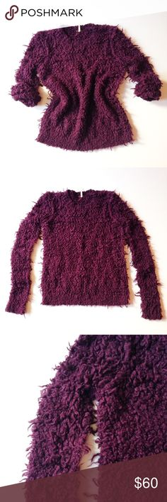 FREE PEOPLE shaggy sweater Soft, shaggy, cool dark burgundy/purple color. Length appx 26, sleeve appx 30. Pit to pit appx 19. Thank you for visiting my closet. Feel free to ask me any questions. I am here to help. 99% of the time I ship the next day. :) Free People Sweaters