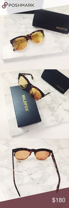 WILDFOX Clubfox Deluxe Mirrored Sunglasses wildfox  clubfox deluxe sunglasses   features italian acetate contrasted by metal-rimmed lens. flash gold mirrored lens. handmade w/ italian acetate. CR39 optical grade lenses offering uv a & b protection.   ⠀† montage   ⠀† 54mm eye W, 20mm bridge W,       145mm temple L ⠀† new in box; case & cleaning cloth   host pick!   ⠀6.3.16 › style obsessions  ⠀6.4.16 › best in jewelry & accessories  ⠀6.12.16 › weekend wardrobe  ⠀6.13.16 › best in jewelry…