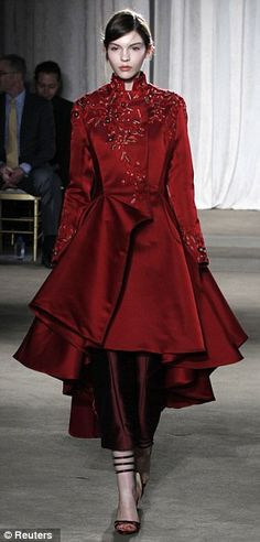 Seventeenth-century romanticism: Marchesa's first fall 2013 look showed a scarlet equestrian coat with a high collar and full skirt - paired with compelling silk matador trousers