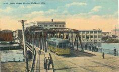 Circa 1910 postcard of the Main Street Bridge in Oshkosh, Wisconsin. From the Oshkosh Public Museum.