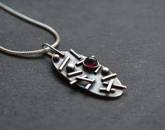 Sterling silver oval pendant with garnet. Garnet by Kailajewellery