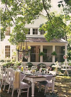 farm table & chairs - this so reminds me of my childhood.  Huge trees.  Family.  A screened porch.  Cousins as far as the eye can see.