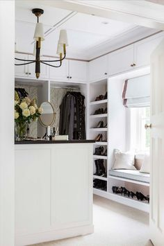 dream walk in closet - note the wallpaper on inside panels and the lighting fixture