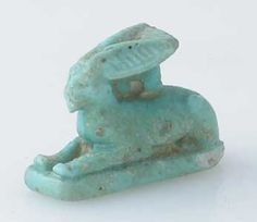 "New Kingdom Faience Amulet of a Hare - PF.2950 Origin: Egypt Circa: 1600 BC to 600 BC  Dimensions: .75"" (1.9cm) high x .375"" (1.0cm) wide  Collection: Egyptian Medium: Faience"